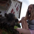Vídeo Stock: Teenage girl caressing black calf shot form below