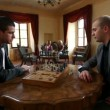 Two business men playing chess in an old fashioned restaurant — Stock Video #28363013