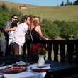 Two couples looking at nature before eating cold cuts — Stock Video