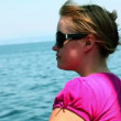 Shot of the young woman on a boat looking at the sea — Stock Video
