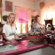 Stock Video: Attractive young women leaving chocolate shop
