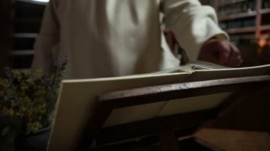 Close up of a monk reading a book — Stockvideo