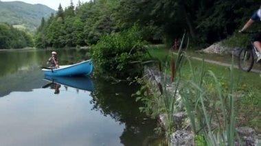 Young man fishing at a beautiful lake — Stock Video