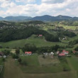 Panorama slide shot from helicopter representing beautiful green valley with highway in the middle — Stock Video