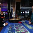 Young coople flirting and playing roulette in casino — Stock Video
