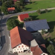 Panorama slide shot from helicopter representing roof covered with solar power station — Stock Video #28391641