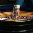 Casino worker and roulette — Stockvideo