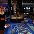 Casino worker giving the the winning chips to a gambler and his mistress — Stock Video