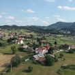 Panorama slide shot from helicopter representing  valley with small towns with lots of houses and other infrastructures — Stock Video