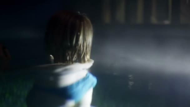 Woman in the pool at night — Vidéo