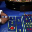 Stock Video: Gambler getting his winning chips
