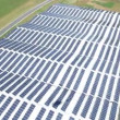 Panorama slide shot from helicopter representing  roof covered with solar power station — Stock Video