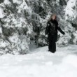 Young woman enjoying walking in deep snow — Stock Video