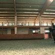 Big hall for training young girl riding horse for equestrianism — Stock Video #28406543