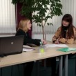 Woman long-haired employee at business meeting with CEO — Stock Video