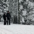 Couple walking on snowy road — Stock Video