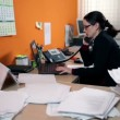 Business woman in office behind computer making a call — Vídeo Stock