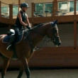 Young girl training for professional jockey — Stock Video #28408411