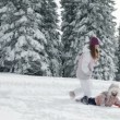 Mother and two children enjoying on snow in idyll — Video