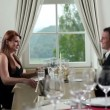 Young couple having romantic dinner in fency restaurant — Stock Video