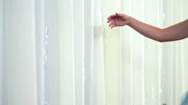 Woman's hand shimmering curtains and piseces of glass — Stock Video