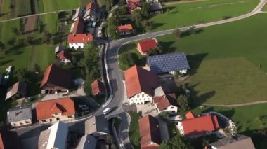 Panorama slide shot from helicopter representing valley with fields, meadows, forest and few houses — Stock Video