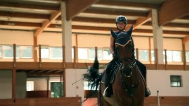 Big hall for training young girl riding horse for equestrianism — Stock Video