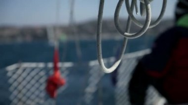 Detail of hanging rope while preparing for sailing — Stock video