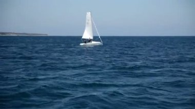 Sailboat in the wide empty sea — Stock Video