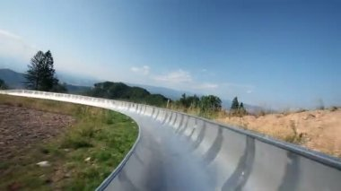 Young people driving with bobsled closely together — Stock Video