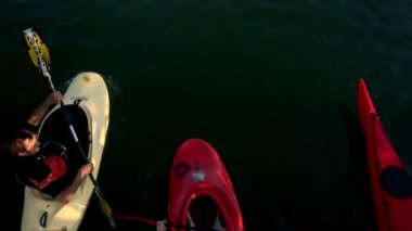 Young people canoeing in the lake towards camera — Stock Video