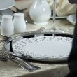 Decorative place setting for romantic dinner and waiter who brings young man delicious starter — Stock Video