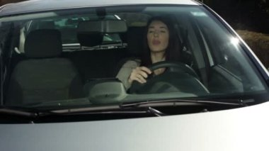 Young woman in a car — Stock Video