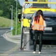 Car stopping to help woman in distress — Vídeo de stock