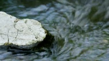 Extreme close up of rock in water stream — Stock Video
