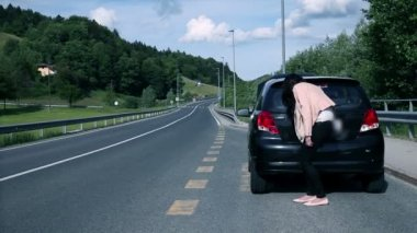 Attractive woman in distress with broken car making a call — Stock Video