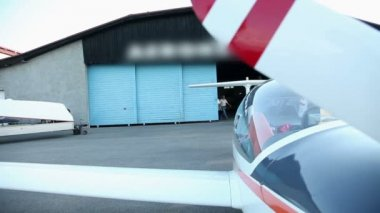 Two man coming from hangar ready for flight — Stock Video