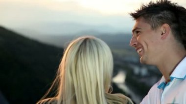 Young couple having fun while enjoying view from a castle — Stock Video