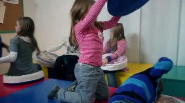 Kids playing in kindergarten with pillows — Stock Video