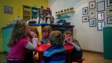Children version of pub with kids having fun — Stock Video