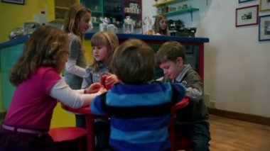 Kids pub with children being served with juice — Stock Video