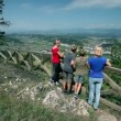 Stock Video: Group of people enjoying the landscape view from hill