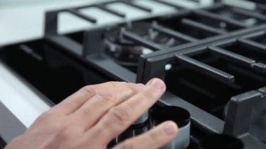 Hand turning on the gas cooker in kitchen — Stock Video