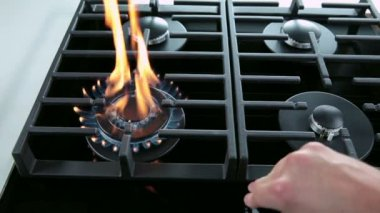 Medium shot of turning on and off gas cooker — Stock Video