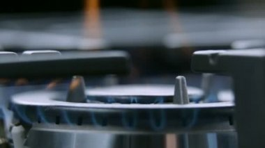 Gas cooker cooktop from close up turning on — Stock Video