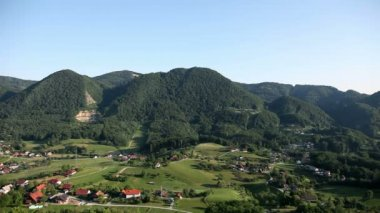 Landscape shot of rural town from higher place — Vídeo de Stock