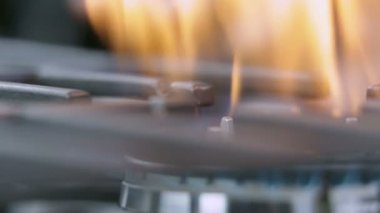 Changing the intensity of fire on gas cooker — Stock Video