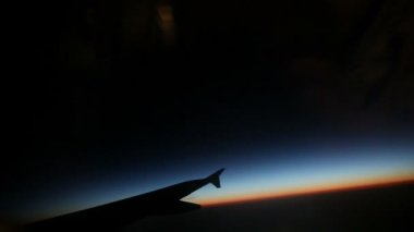 Passenger view from airplane while flying at sunrise — Stock Video