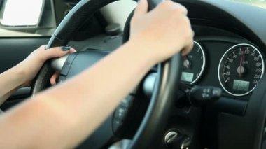 Woman driving car detail on steering wheel — Stock Video