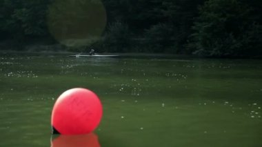 Morning shot of kayaker rowing through lake — Stock Video